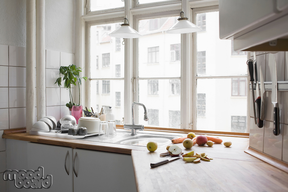 Kitchen worktop with chopped fruit and veg in urban apartment
