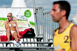 Hot girl with ice cream and Darko Nojic (CRO) at Beachmaster 2011 tournament for Slovenian BeachTour on July 22, 2011, in Ptuj, Slovenia. (Photo by Matic Klansek Velej / Sportida)