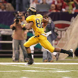 21 December 2008: Southern Miss wide receiver Gerald Baptiste (86) on his way to a touchdown on a catch and run during the first half of the R+L Carriers New Orleans Bowl between the Southern Mississippi Golden Eagles and the Troy Trojans at the New Orleans Superdome in New Orleans, LA.