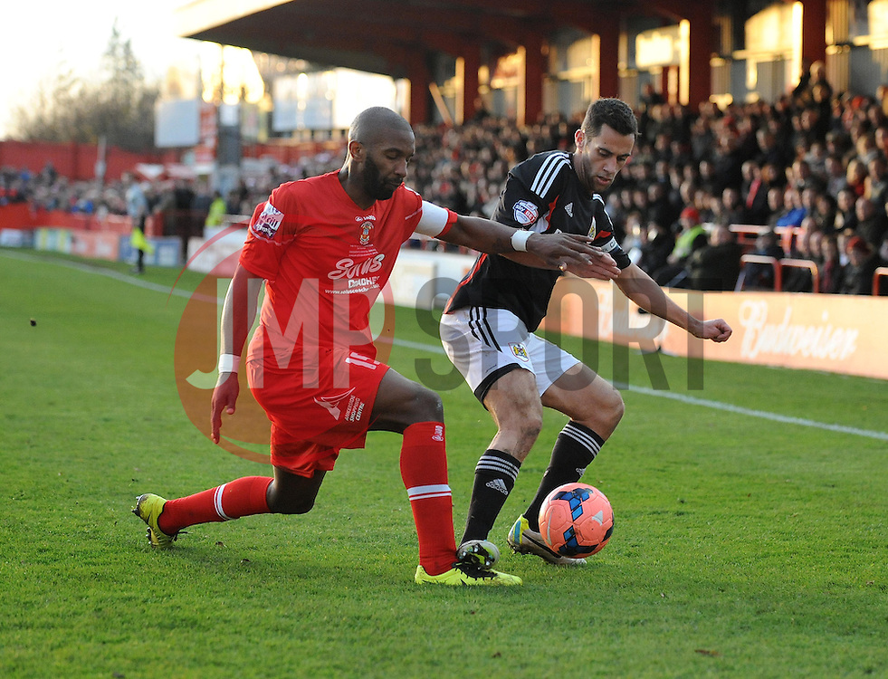 Bristol City's Sam Baldock keeps the ball away from Tamworth's Duane Courtney - Photo mandatory by-line: Dougie Allward/JMP - Tel: Mobile: 07966 386802 08/12/2013 - SPORT - Football - Tamworth - The Lamb Ground - Tamworth v Bristol City - FA Cup - Second Round