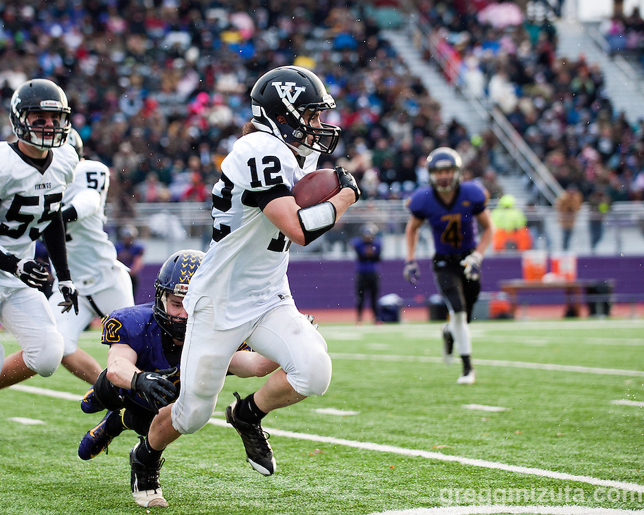 Vale junior Zac Jacobs evades Harrisburg's Hunter Knox for a 9 yard gain and first down in the first quarter of the Oregon 3A State Championship game at Kennison Field, Hermiston, Oregon, November 29, 2014. Vale defeated Harrisburg 45-19 to end the season with a 12-0 record and Vale's 11th state football title.<br />