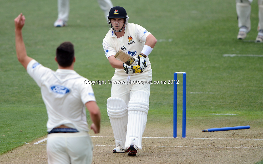 Wellington's Michael Papps is bowled by Michael McClenaghan. Plunket Shield Cricket, Auckland Aces v Wellington Firebirds at Eden Park Outer Oval. Auckland on Monday 26 November 2012. Photo: Andrew Cornaga/Photosport.co.nz