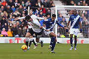 Derby County midfielder George Thorne and Birmingham City FC midfielder David Davis shirt-pulling during a challenge during the Sky Bet Championship match between Derby County and Birmingham City at the iPro Stadium, Derby, England on 16 January 2016. Photo by Aaron Lupton.