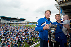 Bristol Rovers' Tom Parkes and Bristol Rovers' Lee Mansell pose for a photo with the Vanarama Conference Play-Off final trophy - Photo mandatory by-line: Dougie Allward/JMP - Mobile: 07966 386802 - 25/05/2015 - SPORT - Football - Bristol - Bristol Rovers Bus Tour