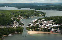 A steady flow of traffic begins to arrive on Saturday for the beginning of Laconia's Motorcycle Week as seen from Lakes Biplane looking down on Weirs Boulevard.  Karen Bobotas Photographer