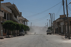 Syria<br /> Smoke emerges on top of a building right after the first of two shells landed shoot from a close Syrian army position.<br /> <br /> Rebels and activist have been reporting of heavy clashes between factions of rebels and the Syrian forces in the area of Alrami village and around the town of Ariha. Also, in the last 48 hours reports of shelling also in the towns close to Ariha as the government troops are trying to control the Highway that leads to Latakia provinc, Syria<br /> Friday, 21st June 2013<br /> Picture by Daniel Leal-Olivas / i-Images