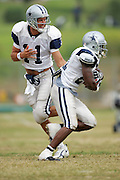 OXNARD, CA - AUGUST 17:  Quarterback Drew Bledsoe #11 of the Dallas Cowboys hands the ball off to running back Julius Jones #21 during Dallas Cowboys training camp on August 17, 2006 in Oxnard, California. ©Paul Anthony Spinelli *** Local Caption *** Drew Bledsoe;Julius Jones