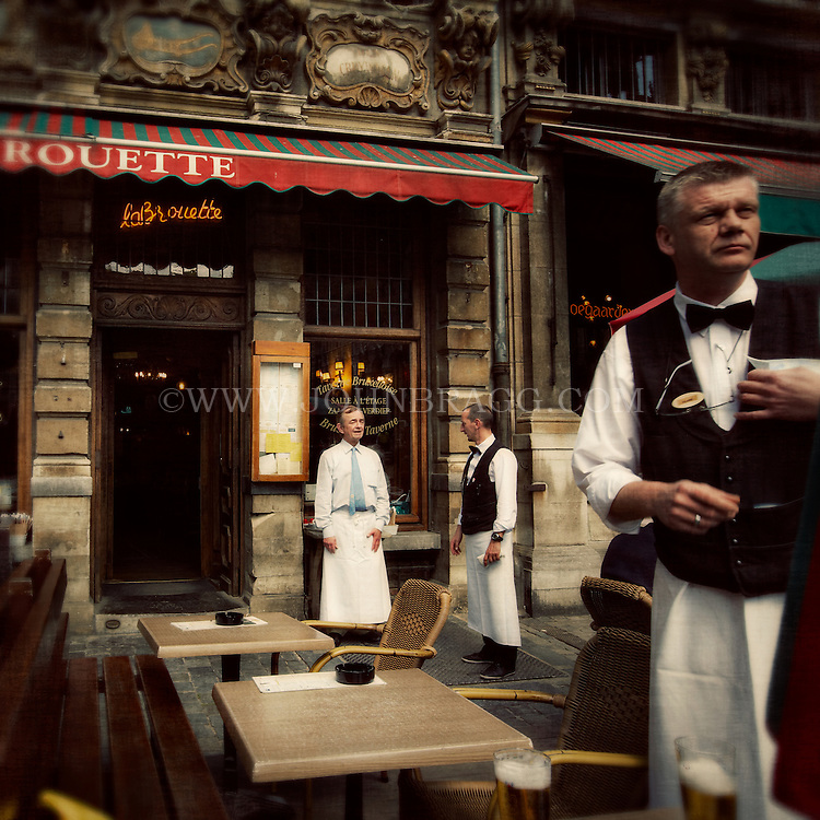 Portrait of waiters outside La Brouette restaurant in Grand Place, Brussels, Belgium