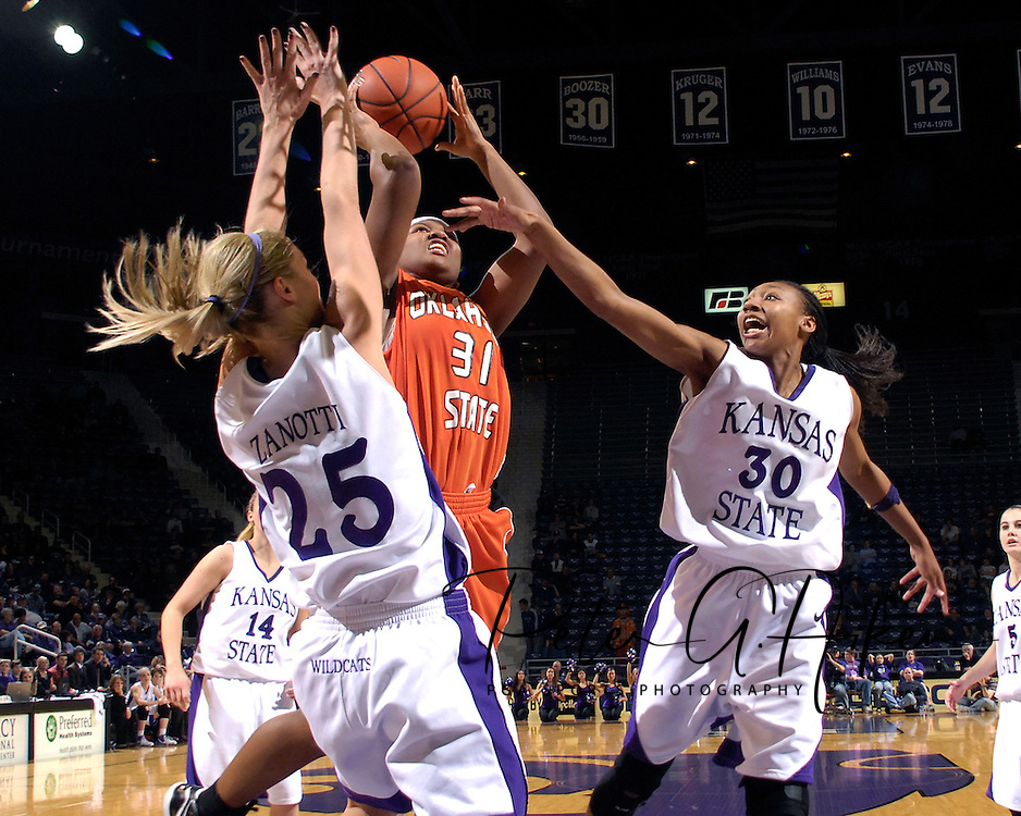 Oklahoma State guard Danielle Green (31) puts up a shot under pressure from Kansas State defenders Danielle Zanotti (25) and Shana Wheeler (30), during second half action at Bramlage Coliseum in Manhattan, Kansas, February 28, 2007.  Oklahoma State beat K-State 64-55.