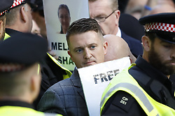 © Licensed to London News Pictures . 27/09/2018. London, UK. Former EDL leader Tommy Robinson (real name Stephen Yaxley-Lennon ) arrives at the Old Bailey , where he faces a retrial for Contempt of Court following his actions outside Leeds Crown Court in May 2018 . Robinson was already serving a suspended sentence for the same offence when convicted in May and served time in jail as a consequence , but the newer conviction was quashed by the Court of Appeal and a retrial ordered . Photo credit: Peter Macdiarmid/LNP