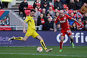 Burton Albion defender Tom Flanagan (2) clears from Bristol City midfielder David Cotterill (32) during the EFL Sky Bet Championship match between Bristol City and Burton Albion at Ashton Gate, Bristol, England on 4 March 2017. Photo by Richard Holmes.