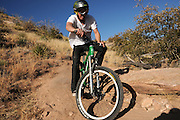 Youths ride mountain bikes on Bug Spring Trail, Mount Lemmon, Santa Catalina Mountains, Sonoran Desert, Tucson, Arizona, USA.