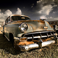 A classic American cruiser rusting away in a field in Texas.