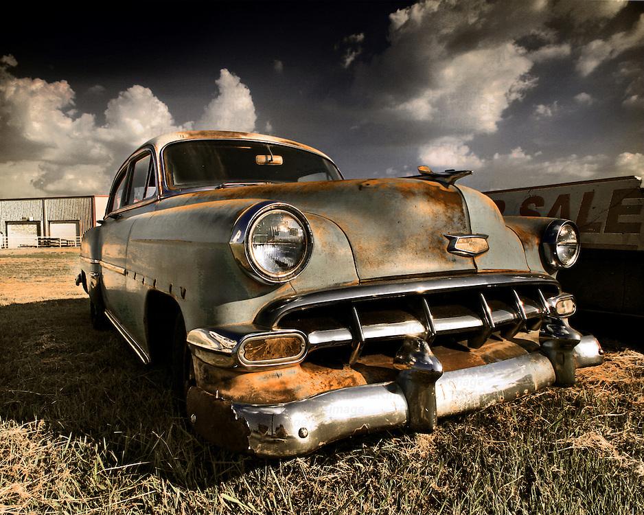 A classic American cruiser rusting away in a field in Texas.