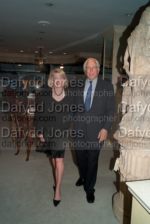LADY LYNN FORRESTER ROTHSCHILD; SIR EVELYN DE ROTHSCHILD, An exhibition of watercolours by William Rayner at Mallet's, New Bond St. Party afterwards at Bellami's, bruton Place. London. 16 June 2010. .-DO NOT ARCHIVE-© Copyright Photograph by Dafydd Jones. 248 Clapham Rd. London SW9 0PZ. Tel 0207 820 0771. www.dafjones.com.