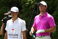 June 22, 2018 - Cromwell, Connecticut, United States - Rory McIlroy (R) and his caddie wait on the 9th tee during the second round of the Travelers Championship at TPC River Highlands. (Credit Image: © Debby Wong via ZUMA Wire)