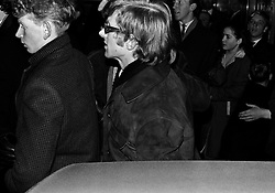 The Rolling Stones Charlie is my Darling - Ireland 1965 -..Rolling Stones manager Andrew Loog Oldham arriving at The Rolling Stones press conference at the Adelphi Theatre, Middle Abbey Street, Dublin. This was the band's first Irish tour of 1965....07/01/1965.01/07/1965.07 January 1965...The Rolling Stones Charlie is my Darling - Ireland 1965.Out November 2nd from ABKCO.Super Deluxe Box Set/Blu-ray and DVD Details Revealed. .ABKCO Films is proud to join in the celebration of the Rolling Stones 50th Anniversary by announcing exclusive details of the release of the legendary, but never before officially released film, The Rolling Stones Charlie is my Darling - Ireland 1965.  The film marked the cinematic debut of the band, and will be released in Super Deluxe Box Set, Blu-ray and DVD configurations on November 2nd (5th in UK & 6th in North America).. .The Rolling Stones Charlie is my Darling - Ireland 1965 was shot on a quick weekend tour of Ireland just weeks after ?(I Can't Get No) Satisfaction? hit # 1 on the charts and became the international anthem for an entire generation.  Charlie is my Darling is an intimate, behind-the-scenes diary of life on the road with the young Rolling Stones featuring the first professionally filmed concert performances of the band's long and storied touring career, documenting the early frenzy of their fans and the riots their live performances incited.. .Charlie is my Darling showcases dramatic concert footage - including electrifying performances of ?The Last Time,? ?Time Is On My Side? and the first ever concert performance of the Stones counterculture classic, ?(I Can't Get No) Satisfaction.?  Candid, off-the-cuff interviews are juxtaposed with revealing, comical scenes of the band goofing around with each other. It's also an insider's glimpse into the band's developing musical style by blending blues, R&B and rock-n-roll riffs, and the film captures the spark about to combust into The Greatest Rock and Roll Band in the World.. .