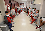 Equipment managers work in the Mal Moore Athletic Facility to get the University of Alabama football team ready for the trip to Baton Rouge to face LSU.  Equipment manager Jeff Springer relies on a staff of students who are poised for instructions for the load out.  Photo by Gary Cosby Jr.
