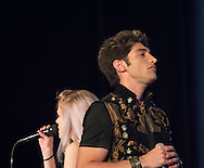"Bellmore, New York, USA. July 21, 2016.  Singers ROBBIE ROSEN, of American Idol top 8 Boys from Merrick, and SARAH BARRIOS perform the duet ""Chains"" at the 19th Annual Long Island International Film Expo Awards Ceremony, LIIFE 2016, held at the historic Bellmore Movies. LIIFE was called one of the 25 Coolest Film Festivals in the World by MovieMaker Magazine."