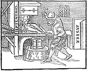 Forging a magnet. From William Gilbert 'De Magnete', London, 1600. Metal on the anvil is aligned North/South (Septentrio/Auster). Woodcut