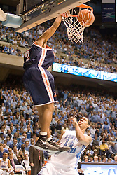 J.R. Reynolds (2) dunks the ball as University of North Carolina's Danny Green (14) watches on defense.  Despite Reynolds' team-high 15 points, the #1 ranked Tar Heels beat the Cavaliers 79-69 to improved to 15-1 overall, 2-0 ACC on January 10, 2007 at the Dean Smith Center in Chapel Hill, NC.<br />
