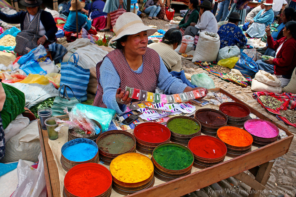 Americas, South America, Peru, Pisac. Market vendor selling colorful pigments.