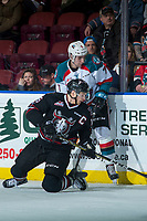 KELOWNA, CANADA - FEBRUARY 14:  Grayson Pawlenchuk #16 of the Red Deer Rebels digs for the puck at the boards beneath Libor Zabransky #7 of the Kelowna Rockets on February 14, 2018 at Prospera Place in Kelowna, British Columbia, Canada.  (Photo by Marissa Baecker/Shoot the Breeze)  *** Local Caption ***