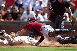 May 30, 2010; San Francisco, CA, USA;  San Francisco Giants third baseman Ryan Rohlinger (29) is tagged out at home plate by Arizona Diamondbacks catcher Chris Snyder (19) during the seventh inning at AT&T Park.  San Francisco defeated Arizona 6-5 in 10 innings.