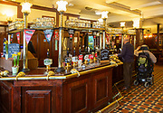 Interior of historic Goat Major pub in city centre of Cardiff, South Wales, UK - bar with Brains beers on sale