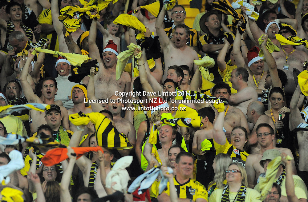 Phoenix fans celebrate during the A-League football match between Wellington Phoenix v Newcastle Jets at Westpac Stadium, Wellington, New Zealand on Friday, 23 December 2011. Photo: Dave Lintott / lintottphoto.co.nz