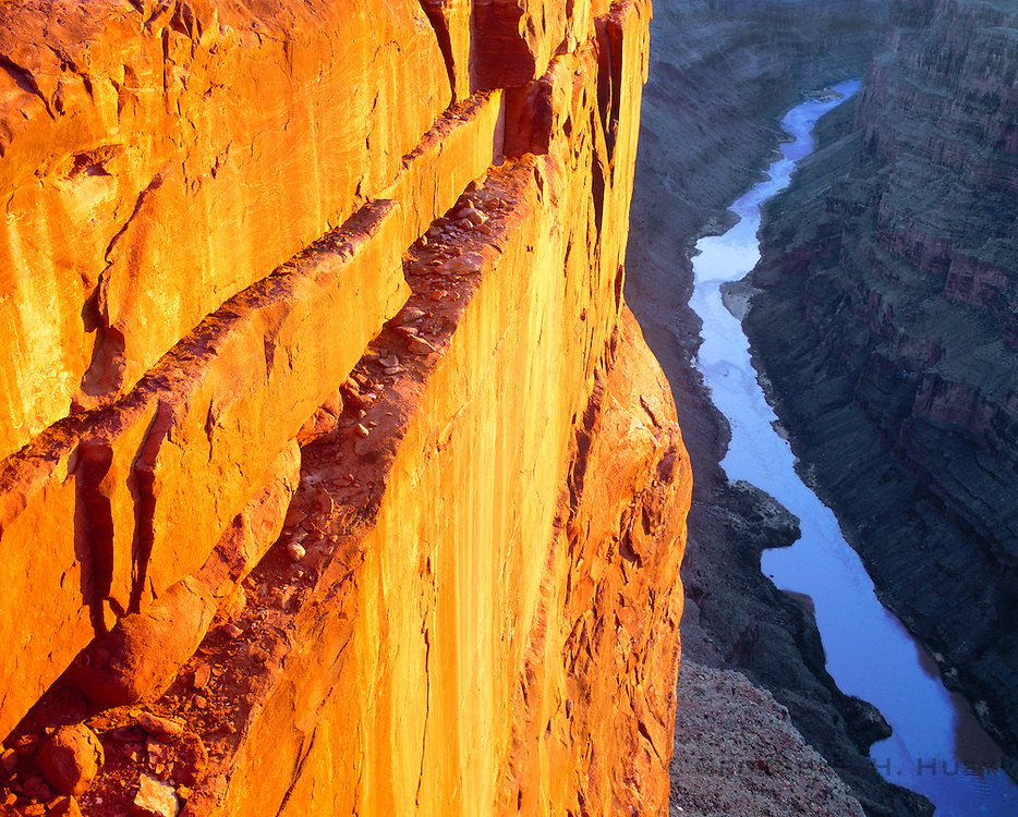0107-1004 ~ Copyright: George H. H. Huey ~ The Colorado River, 3,000 feet below, seen from the Toroweep Overlook, at sunrise. Grand Canyon National Park, Arizona.