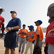 Former MLB player Tony Torchia (second from left) discusses with a local coach before an exhibition baseball game in the city of Tema, roughly 35 km east of Ghana's capital Accra on Saturday February 3, 2007. The game was being held on the occasion of the visit of a delegation from the American Major League Baseball Association made possible by the African Development Foundation, a non-profit organization that supports little league projects in selected African countries.