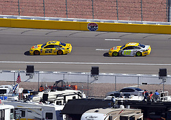 March 4, 2018 - Las Vegas, NV, U.S. - LAS VEGAS, NV - MARCH 04: Joey Logano (22) Team Penske Pennzoil Ford Fusion and Ryan Blaney (12) Team Penske Ford Fusion drive into turn 3 as fans watch from their RV's during the Monster Energy NASCAR Cup Series Pennzoil 400 on March 04, 2018 at Las Vegas Motor Speedway in Las Vegas, NV. (Photo by Chris Williams/Icon Sportswire) (Credit Image: © Chris Williams/Icon SMI via ZUMA Press)