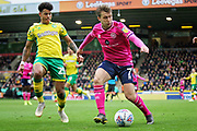 QPR Midfielder Luke Freeman shadowed by Norwich City midfielder Onel Hernández (25) during the EFL Sky Bet Championship match between Norwich City and Queens Park Rangers at Carrow Road, Norwich, England on 6 April 2019.