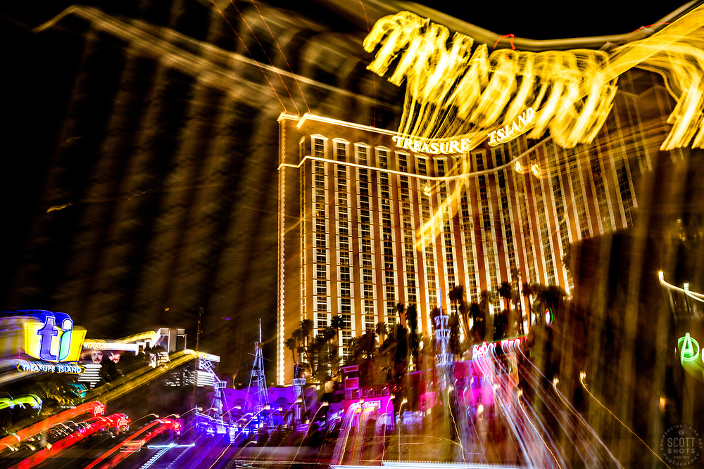 """""""Las Vegas Lights 7"""" - Photograph taken at the Las Vegas, Nevada Strip at night. The look was achieved by shooting a handheld long exposure and zooming the lens during the exposure."""