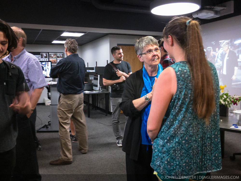 A reception was held for Rita Reed, photojournalism professor at the Missouri School of Journalism, to celebrate her retirement after 16 years of being on the faculty. <br /> <br /> In this photo, Reed speaks with an unidentified student.<br /> <br /> The event was held on May 10, 2017 in the Cliff and Vi Edom Photojournalism Lab in Lee Hills Hall on the University of Missouri campus in Columbia, Mo.<br /> <br /> The following is from Reed&rsquo;s bio posted on the Missouri School of Journalism website: &quot;Rita Reed joined the photojournalism faculty in 2001 after 20 years as a working photojournalist with Star Tribune in Minneapolis and The Gazette in Cedar Rapids, Iowa. She has worked not only on local, regional and national stories, but also internationally in Haiti, Bolivia, Colombia, Taiwan, China and the countries of the former Eastern Block.<br /> <br /> Reed holds a master&rsquo;s degree in journalism from the University of Missouri and an undergraduate degree from Southwest Missouri State University. She was the 1993 recipient of the Nikon Sabbatical Grant for Documentary Photography for the completion of work on a photographic book about gay and lesbian teenagers. Reed maintains an interest in and concern for adolescents and the issues they face. She is the director of the College Photographer of the Year competition.&rdquo;
