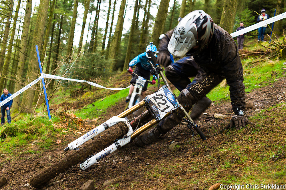Ae Forest, Dumfries, Scotland, UK. 25th April 2015. Downhill Mountain Biker Ali MacCheyne recovers after a fall on the 7Stanes course at Ae during the Scottish Downhill Association racing.