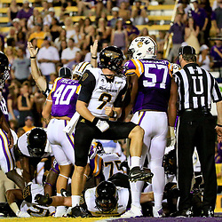 Oct 15, 2016; Baton Rouge, LA, USA;  Southern Miss Golden Eagles quarterback Nick Mullens (9) celebrates after a score by his team during the first quarter of a game against the LSU Tigers at Tiger Stadium. Mandatory Credit: Derick E. Hingle-USA TODAY Sports