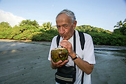 Mature Tourist drinking coconut juice Costa Rica Model Released