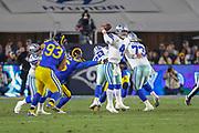 Jan 12, 2019; Los Angeles, CA, USA; Dallas Cowboys quarterback Dak Prescott (4) is pressured by Los Angeles Rams defensive tackles Ndamukong Suh (93) and Matt Longacre (96) during an NFL divisional playoff game at the Los Angeles Coliseum. The Rams beat the Cowboys 30-22. (Kim Hukari/Image of Sport)