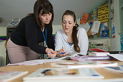 Teacher and student at adult education centre,