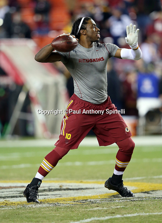 Washington Redskins quarterback Robert Griffin III (10) throws a pass while warming up before the 2015 week 13 regular season NFL football game against the Dallas Cowboys on Monday, Dec. 7, 2015 in Landover, Md. The Cowboys won the game 19-16. (©Paul Anthony Spinelli)