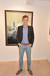 Singer DAN OLSEN at a private view of the exhibition Transcending Boundaries 2015 held at Lacey Contemporary Gallery, Clarendon Cross, Notting Hill, London on 30th April 2015.