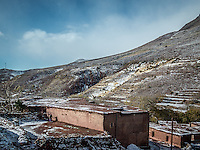 Snow starting to cover the landscape whilst crossing the high atlas mountains, Morocco.