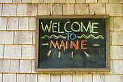 Welcome to Maine sign at a summer cottage in Cushing, Maine.