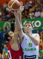 Cetin Serhat of Turkey vs Bostjan Nachbar of Slovenia during friendly match between National teams of Slovenia and Turkey for Eurobasket 2013 on August 4, 2013 in Arena Zlatorog, Celje, Slovenia. (Photo by Vid Ponikvar / Sportida.com)