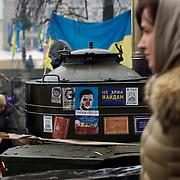 December 18, 2013 - Kiev, Ukraine: A pro-EU demonstrator passes by anti-government posters in Independence Square.<br /> On the night of 21 November 2013, a wave of demonstrations and civil unrest began in Ukraine, when spontaneous protests erupted in the capital of Kiev as a response to the government&rsquo;s suspension of the preparations for signing an association and free trade agreement with the European Union. Anti-government protesters occupied Independence Square, also known as Maidan, demanding the resignation of President Viktor Yanukovych and accusing him of refusing the planned trade and political pact with the EU in favor of closer ties with Russia.<br /> After a days of demonstrations, an increasing number of people joined the protests. As a responses to a police crackdown on November 30, half a million people took the square. The protests are ongoing despite a heavy police presence in the city, regular sub-zero temperatures, and snow. (Paulo Nunes dos Santos/Polaris)