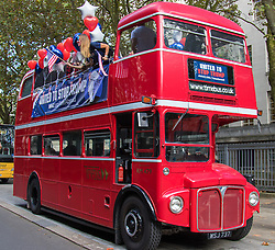 "London, September 21st 2016. A ""Stop Trump"" open topped red London double-decker bus tours central London in a bid to encourage US expats to vote for Clinton. XXXX."