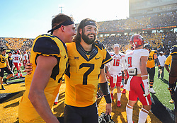 Oct 14, 2017; Morgantown, WV, USA; West Virginia Mountaineers wide receiver David Sills V (13) and West Virginia Mountaineers quarterback Will Grier (7) celebrate after beating the Texas Tech Red Raiders at Milan Puskar Stadium. Mandatory Credit: Ben Queen-USA TODAY Sports