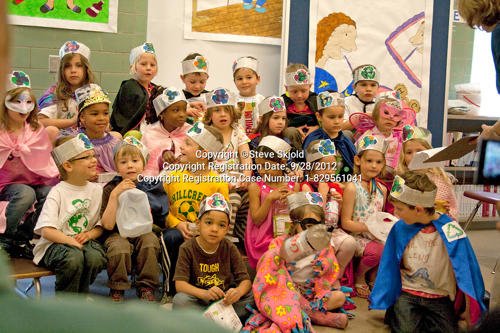 Classroom of racially mixed first grade children presenting a program on recycling. Horace Mann School St Paul Minnesota MN USA